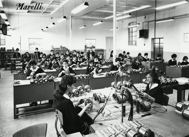 """It is said that """"Ercole Marelli"""" was a good place to work for women. This picture shows some female employee assembling mechanical parts. Milan, 1950s"""