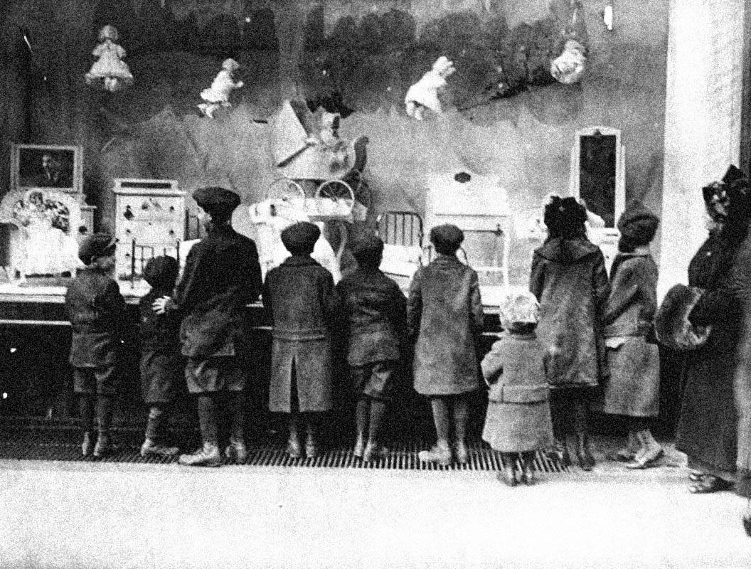 The Christmas display at Macy's in New York attracting crowds of children in 1915