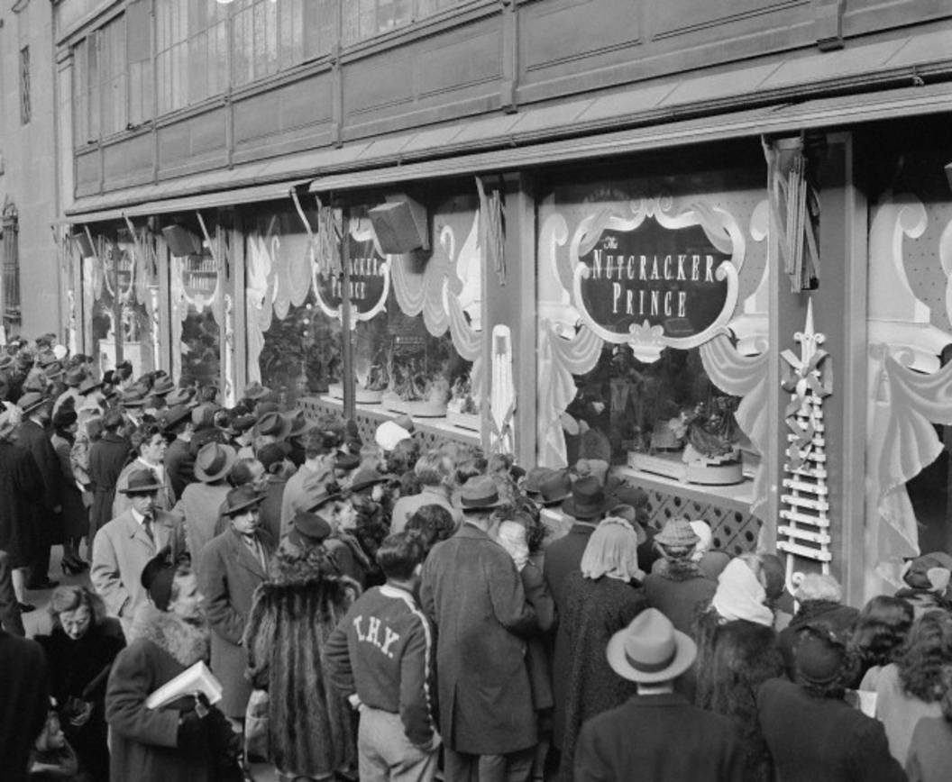 A crowd of people at the unveiling of Macy's holiday display in 1939