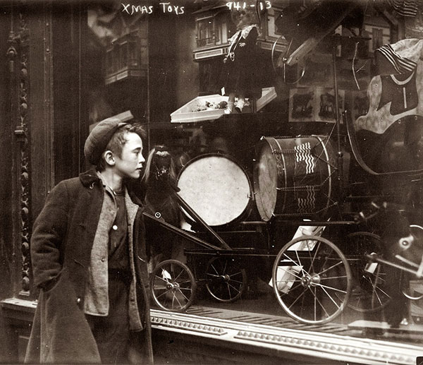 Eyeing a Christmas toy display in New York, circa 1910