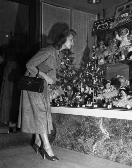 A sweet mama looking for her children's special gift, 1950s