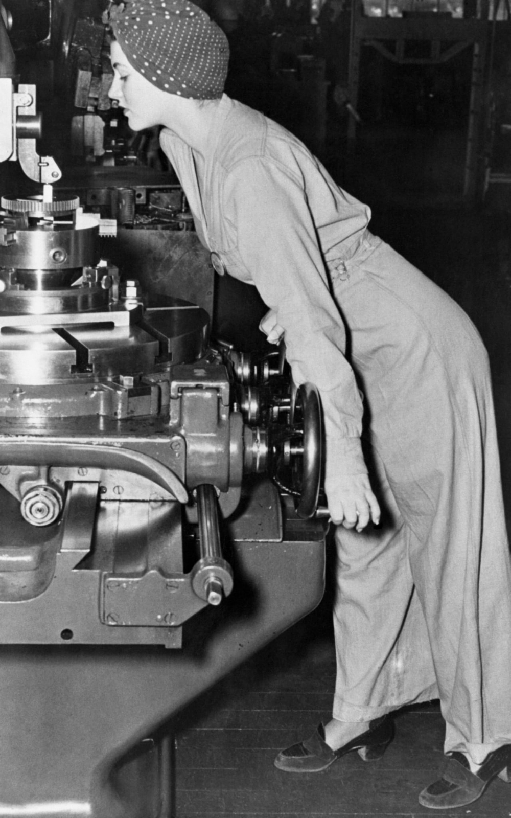 """Naomi Parker, the real-life """"Rosie the Riveter"""", 1942. The original caption read: """"Naomi wears heavy shoes, black suit, and a turban to keep her hair out of harm's way."""""""