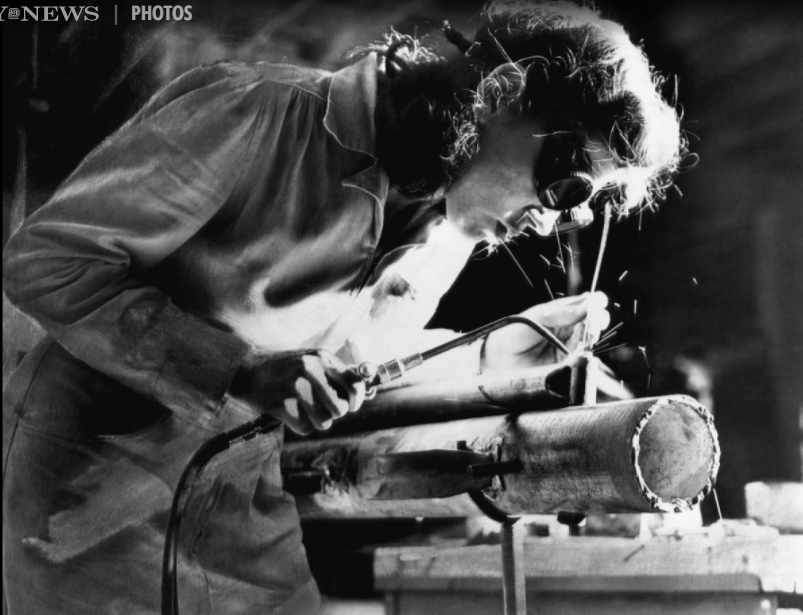 a woman welding a part of a cockpit for the new Army Air Forces TC 4-A training glider in 1942. (picture by Daily News)