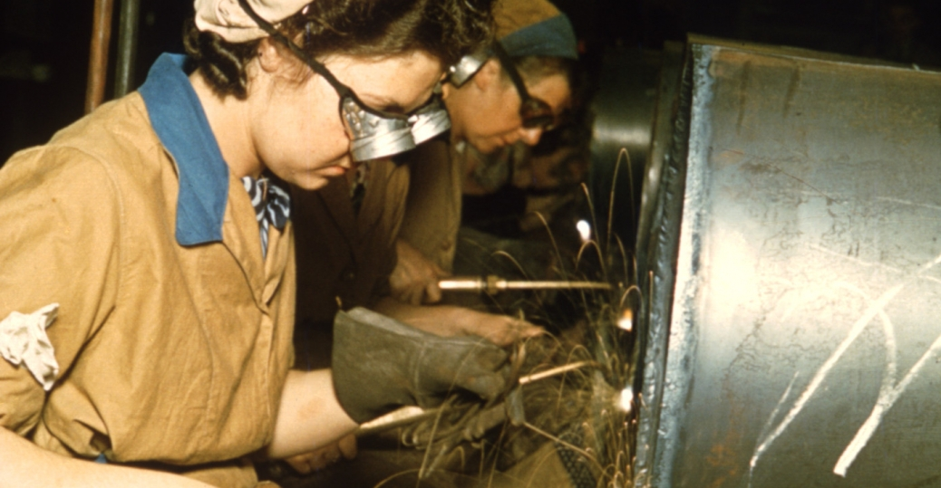 Women went to work on both sides of the Atlantic. This picture, taken in England, shows women working in a munitions factory, 1940s