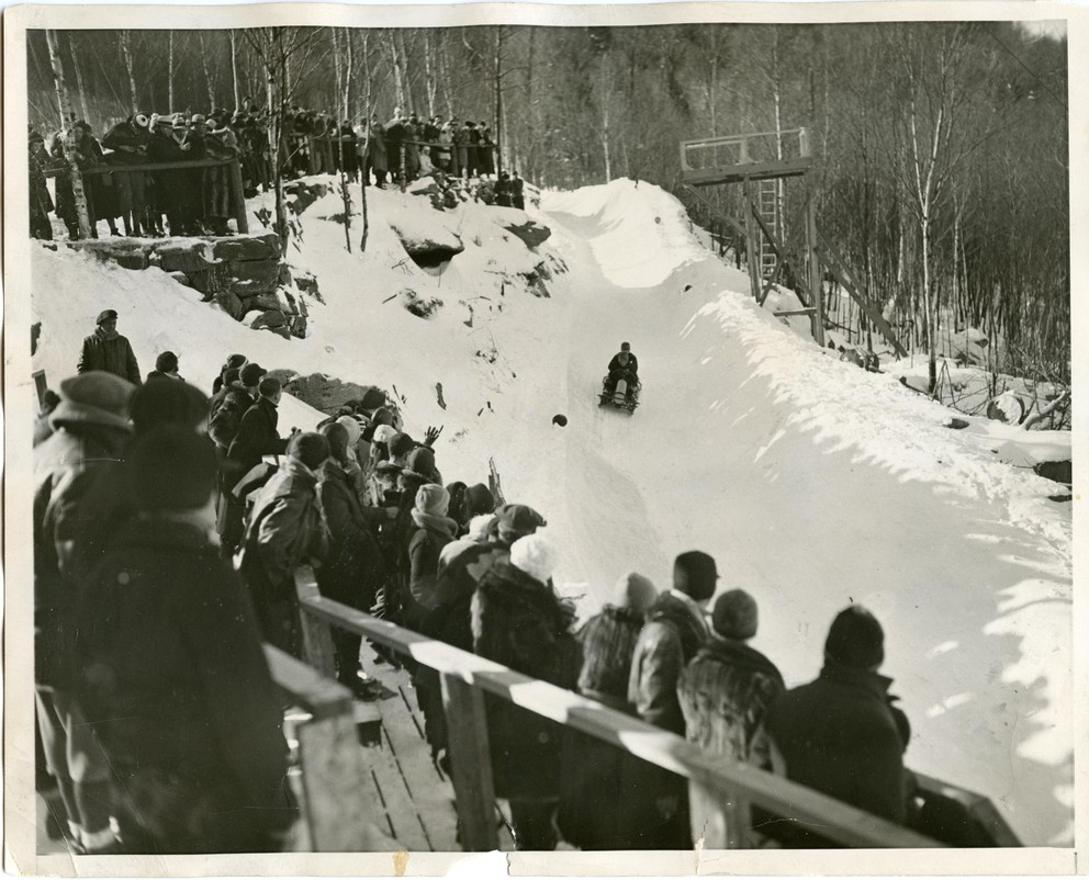 Hubert Stevens and his brother, Curtis Stevens, U.S. representatives in the bob-sled run at Lake Placid, approach the dangerous Whiteface curve as they set their first Olympic record on the first day of competition in 1932. Later, they broke it again. (Courtesy of the 1932/1980 Lake Placid Olympic Museum)
