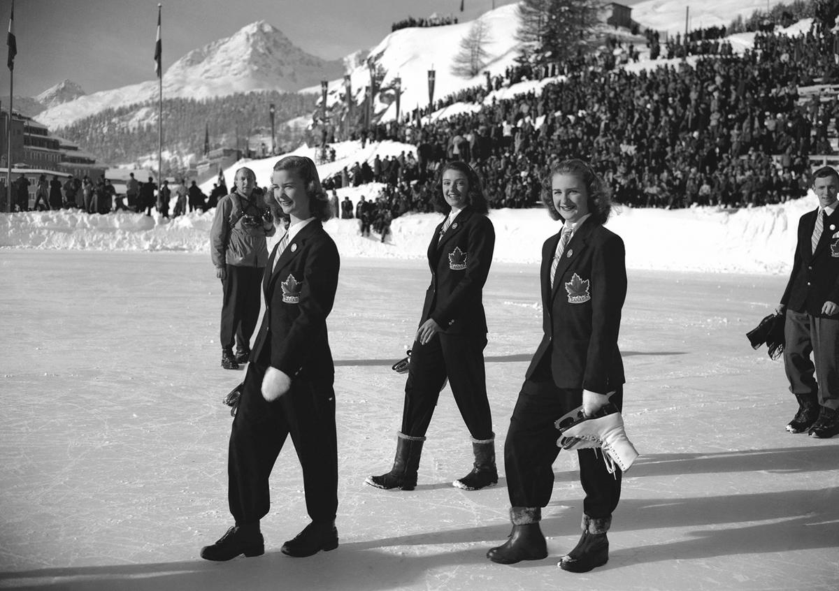 From left, Barbara Ann Scott, Marion Ruth Take, and Susanne Morrow, members of the Canadian Winter Olympic team, March in the opening parade at the ice stadium in St. Moritz, Switzerland, January 1948