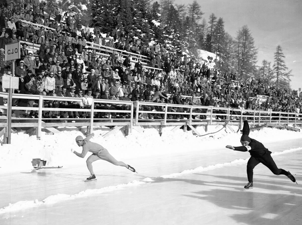 Hijo Chang Lee of Korea, left, and A. Huiskes of Holland, compete in the 500 meter Olympic speedskating, at St Moritz, 1948