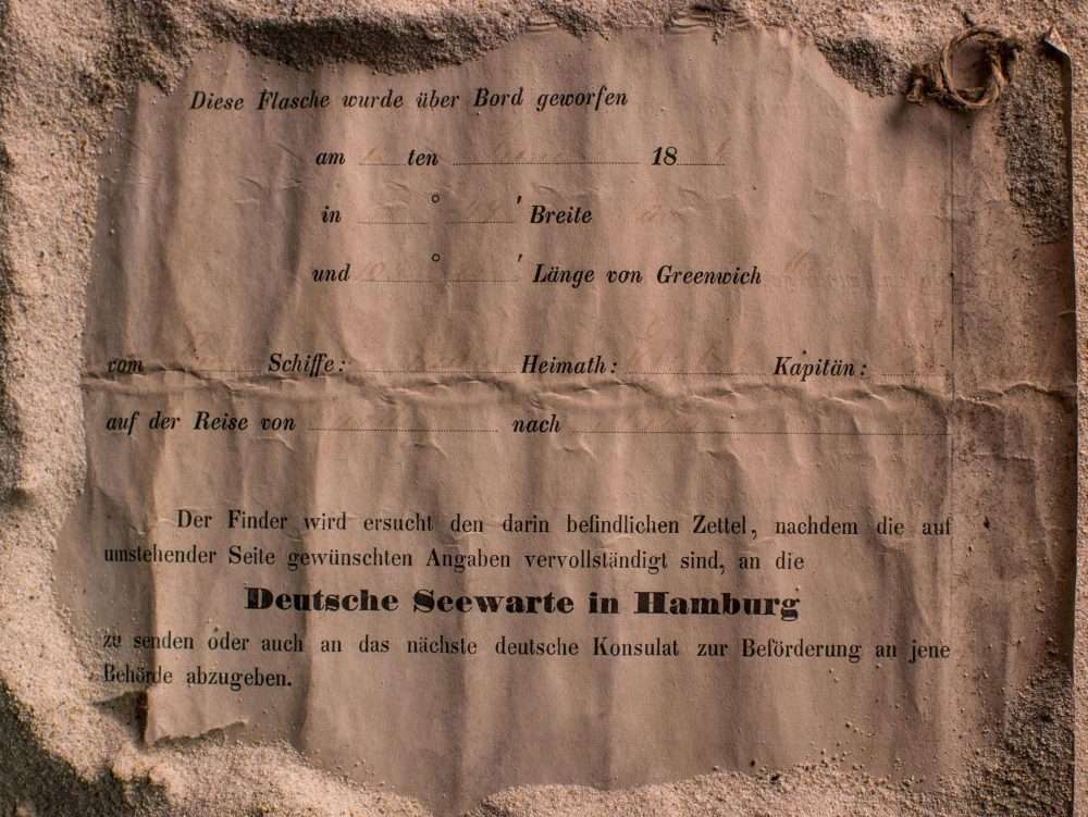 This photo shows an almost 132-year-old message found in a bottle near Wedge Island, some 160 kilometres north of Perth. This message asked the reader to contact the German consulate after the finding.(AFP/Getty Images)
