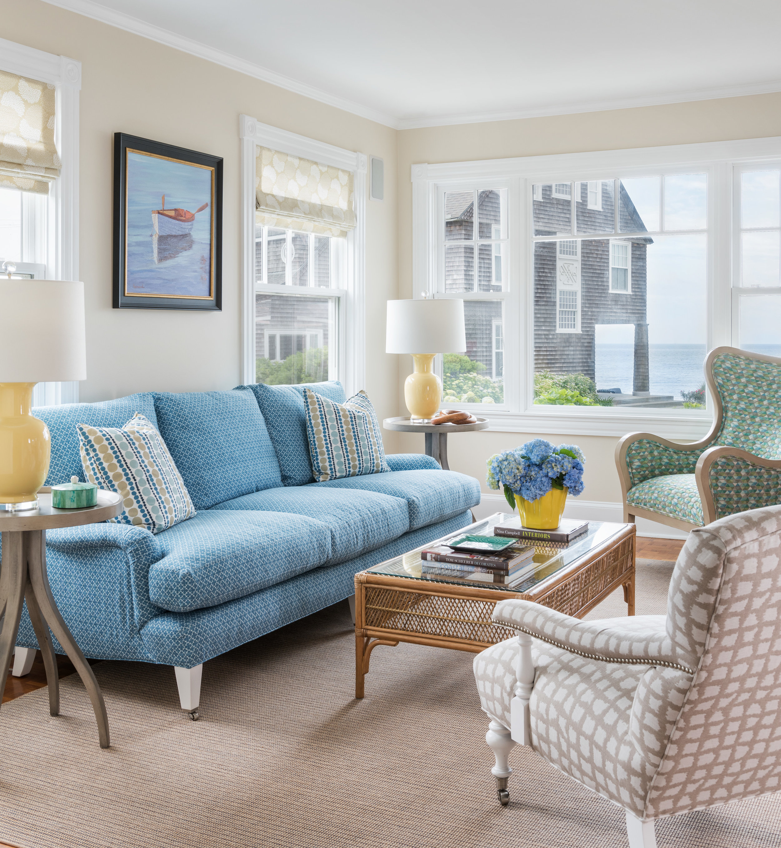 interior design, living room, blue couch, boat painting, ocean view, beach design, beach style