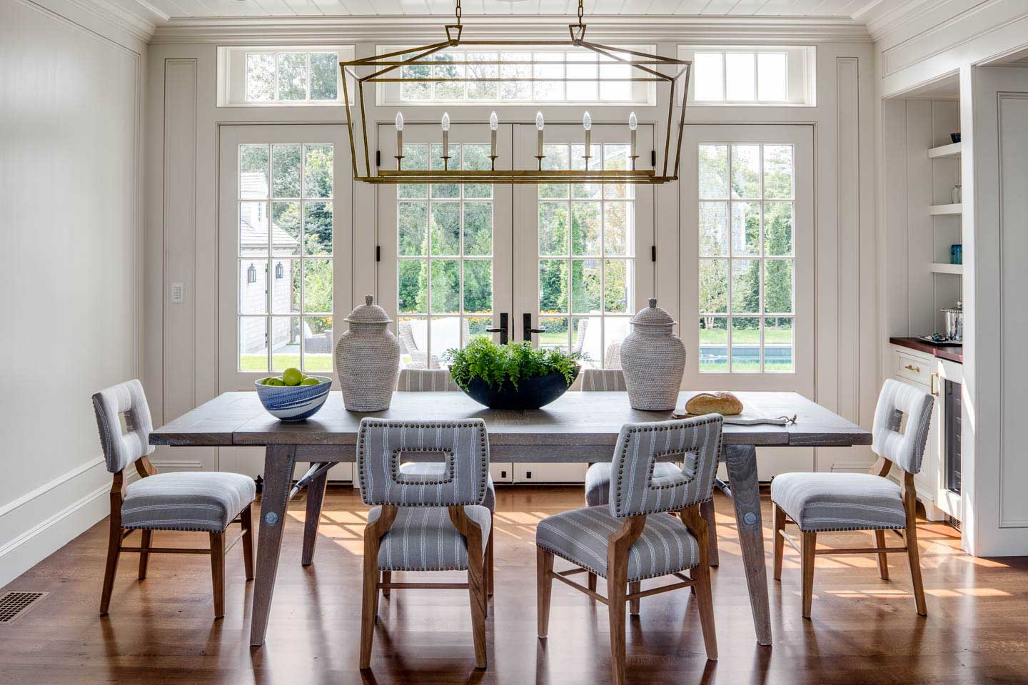 dining room, dining room table, table decor, pendant lighting, french doors