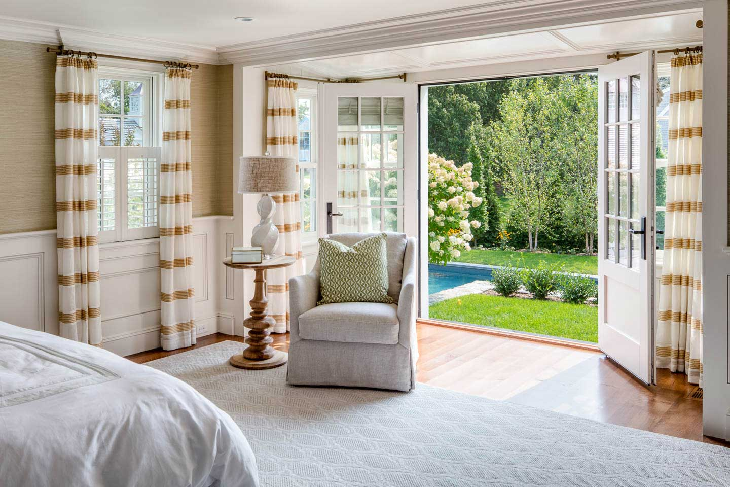 cape house, bedroom, french doors, pool, bedroom seating, interior design