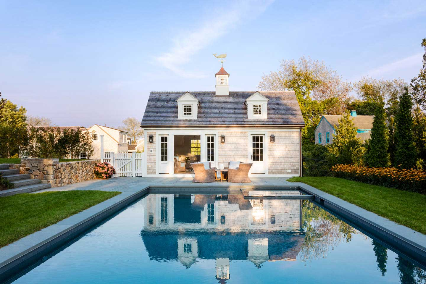 cape house, pool, outdoor seating, pool house, whale, weathervane