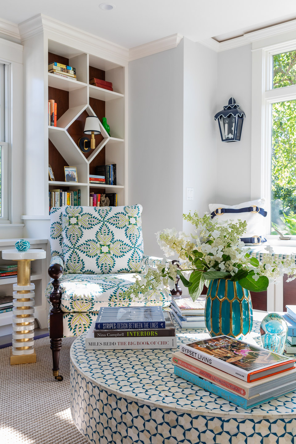 living room decor, family room decor, round coffee table, coffee table books, coffee table styling, vase, flowers, side table, bookcase, bookcase design ideas