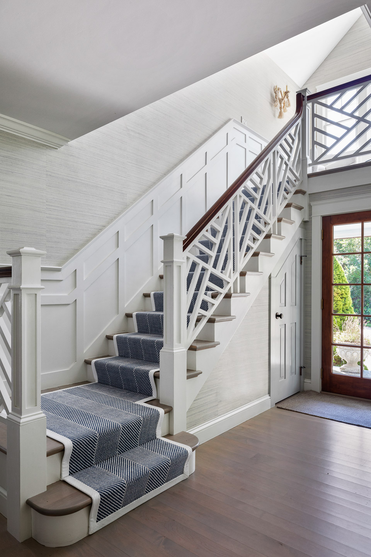 stairway, landing, stairs, stair runner, stair rails, front hall