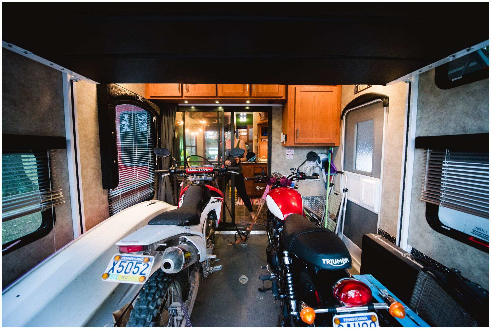 5th wheel toy hauler with bikes in garage