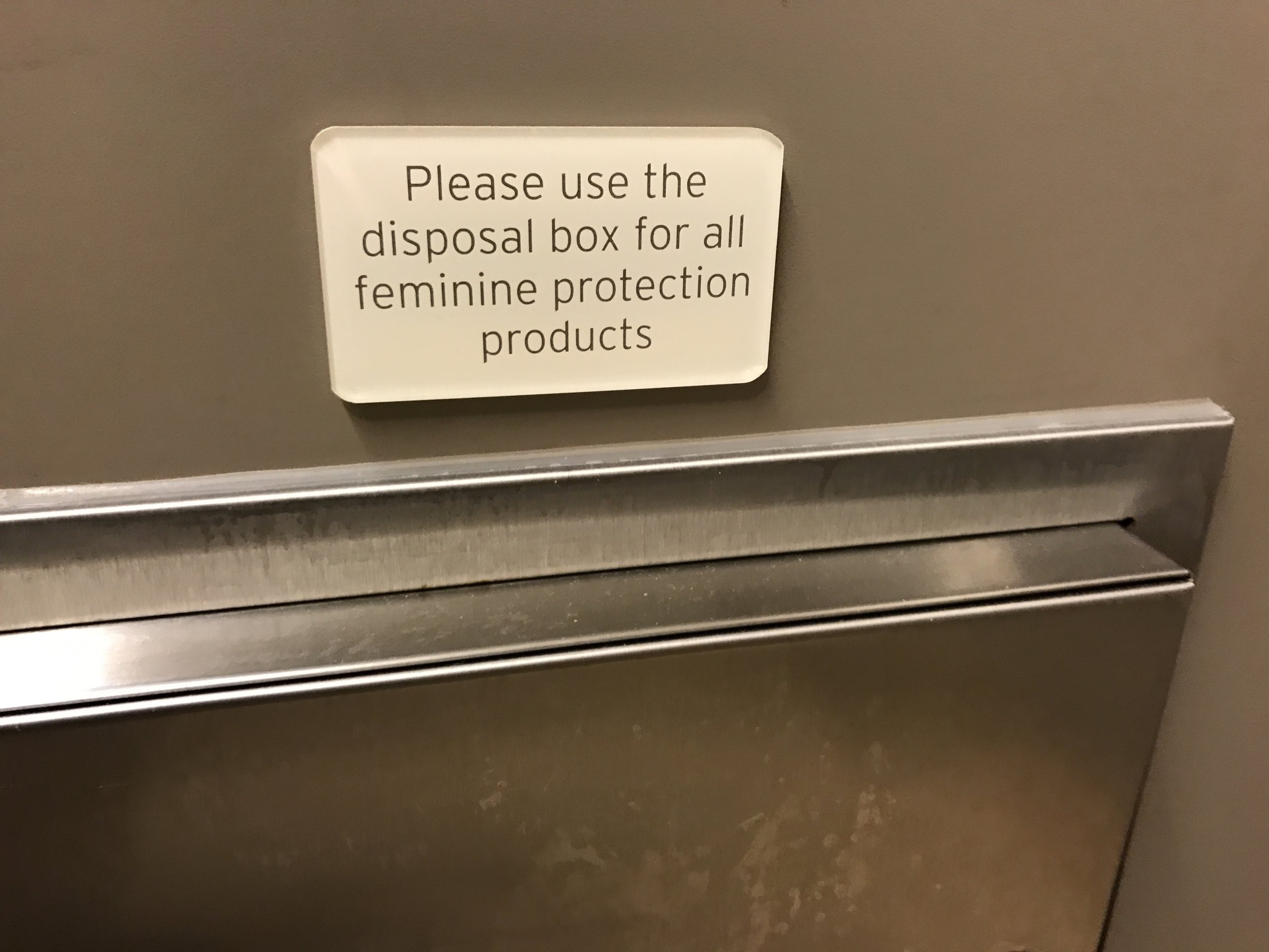 """Photo of Nordstrom's [uncool] """"feminine protection"""" warning."""