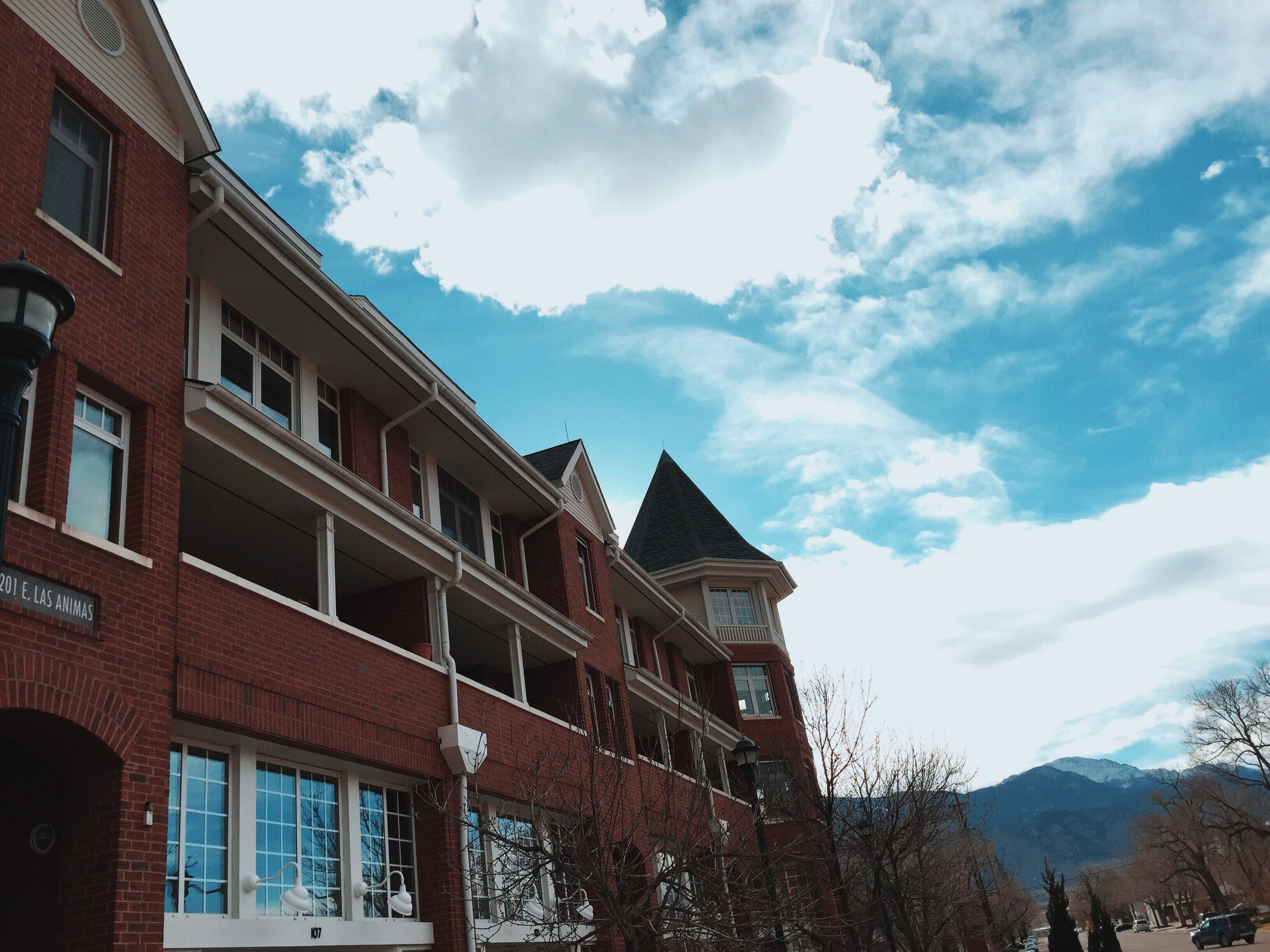 Cool Tone Building with Bright Sky and Pikes Peak.JPG