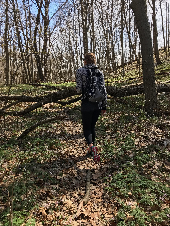 Bachelorette Carolyn forging through the trees in Saugatuck, Michigan.
