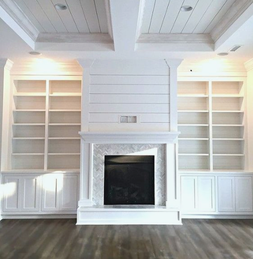 We like the look of shelves going all the way to the ceiling- I think it helps to make the room feel bigger.