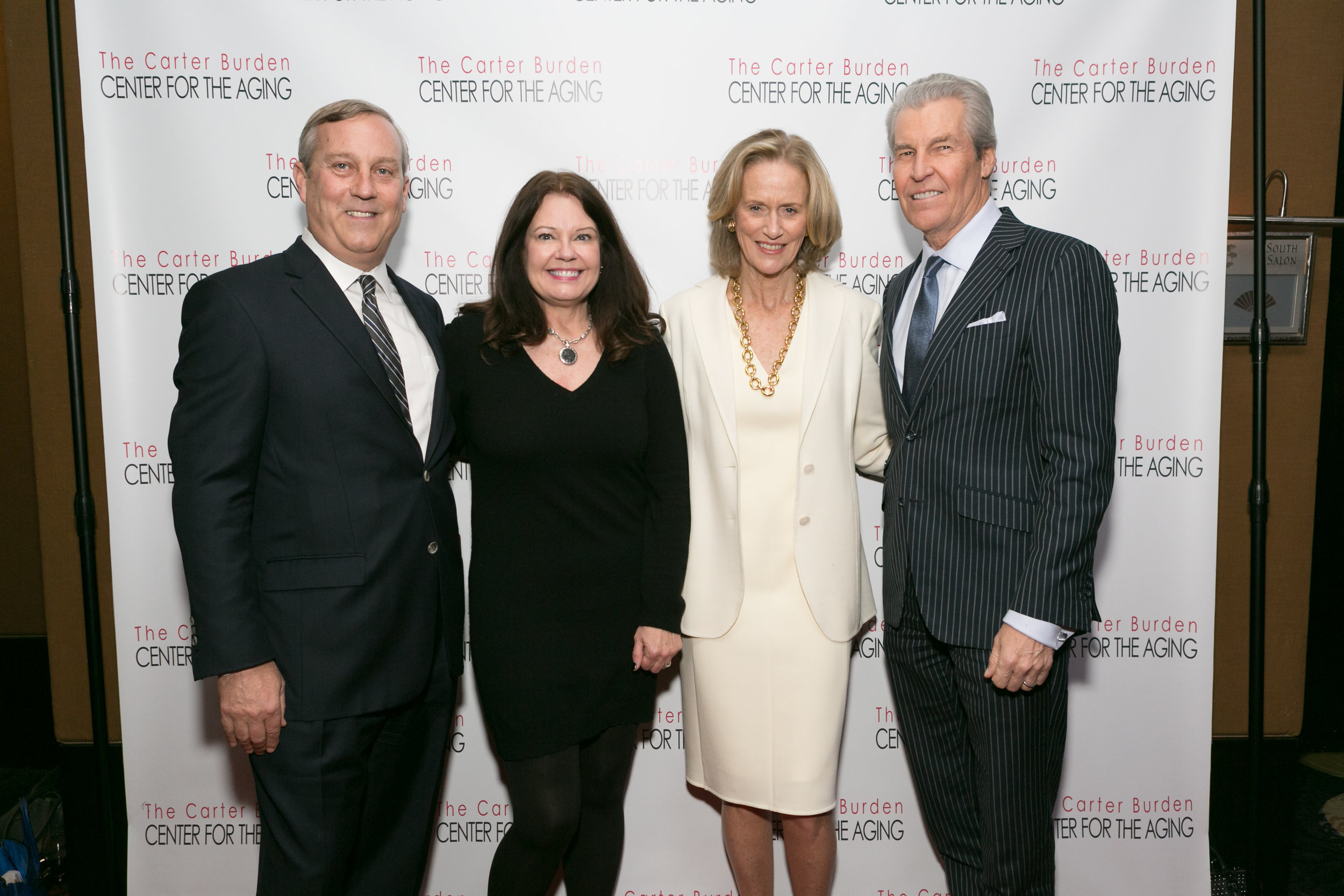 Peter Sachse   , Chief Growth Officer, Macy's, 2016 Business Leadership Honoree and his wife  Jini Sachse;Susan L. Burden , Board Member, Carter Burden Network; Terry J. Lundgren , CEO, Macy's Inc.