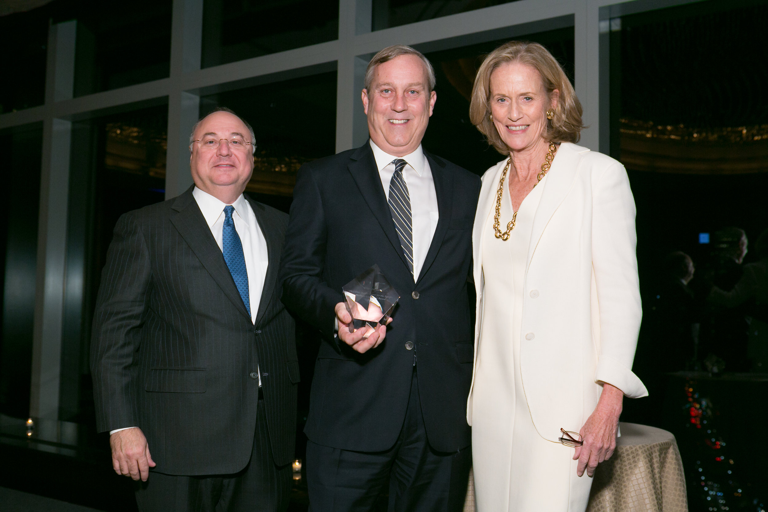 Peter Sachse   , Chief Growth Officer, Macy's, 2016 Business Leadership Honoree accepting his award from  Jeffrey A. Weber , Board Chairman, Carter Burden Network and  Susan L. Burden , Board Member, Carter Burden Network