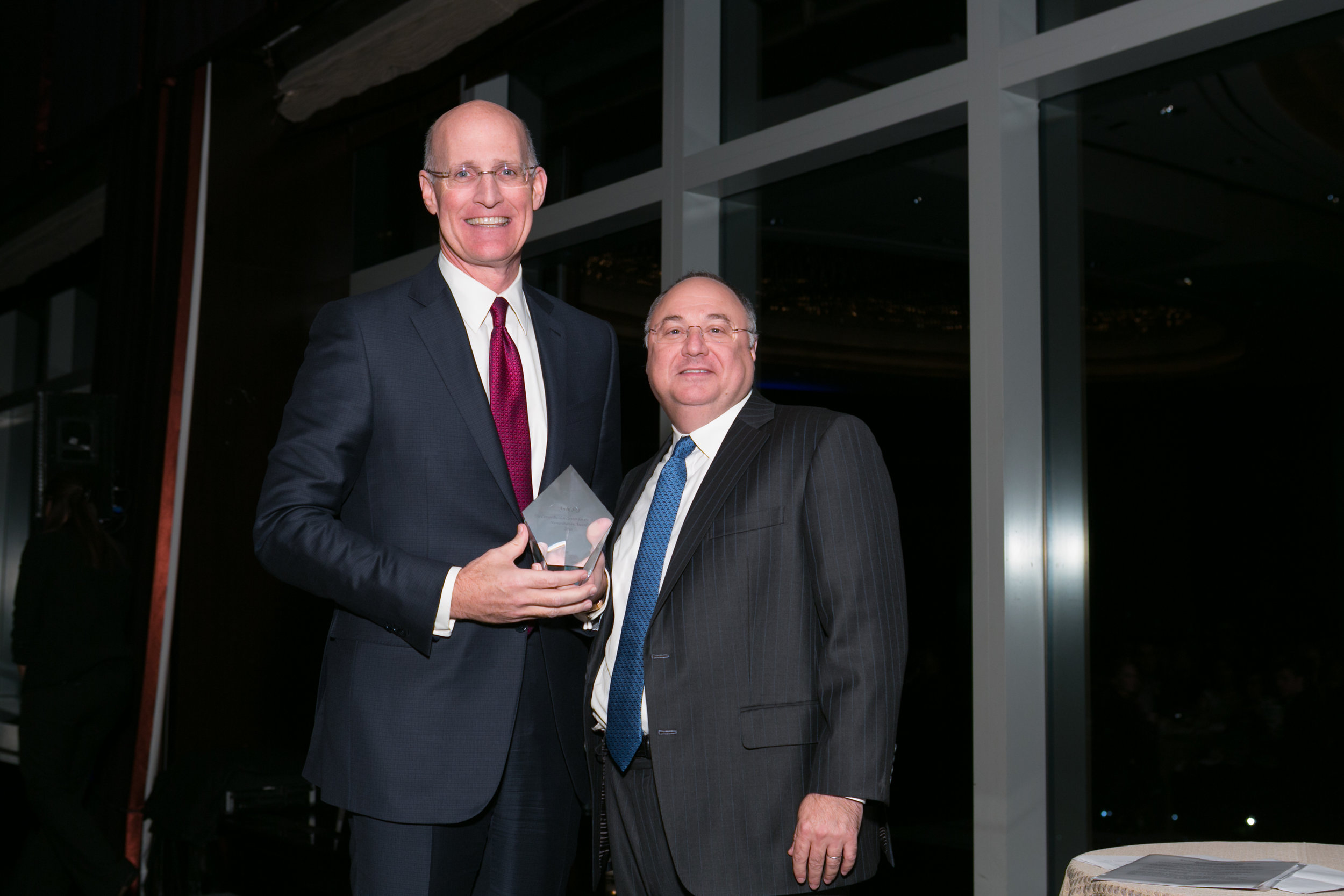 Andy Sieg   , Head of Global Wealth & Retirement Solutions, Bank of America Merrill Lynch, 2016 Humanitarian Honoree accepting his award from  Jeffrey A. Weber , Board Chairman, Carter Burden Network