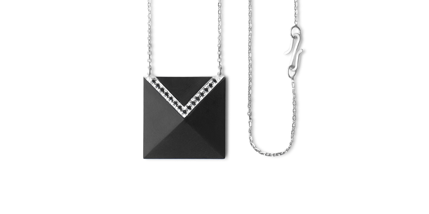 Inlaid Whitby jet pendant with 18CT white gold and black diamonds