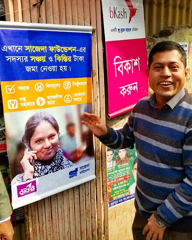 Intrepid counterpart at SAJIDA proudly showing off his eye catching contribution to the colorful marketing poster for mobile money loans with Rocket. #optixproject #sajidafoundation #mobilemoney #fintech #ict4dev