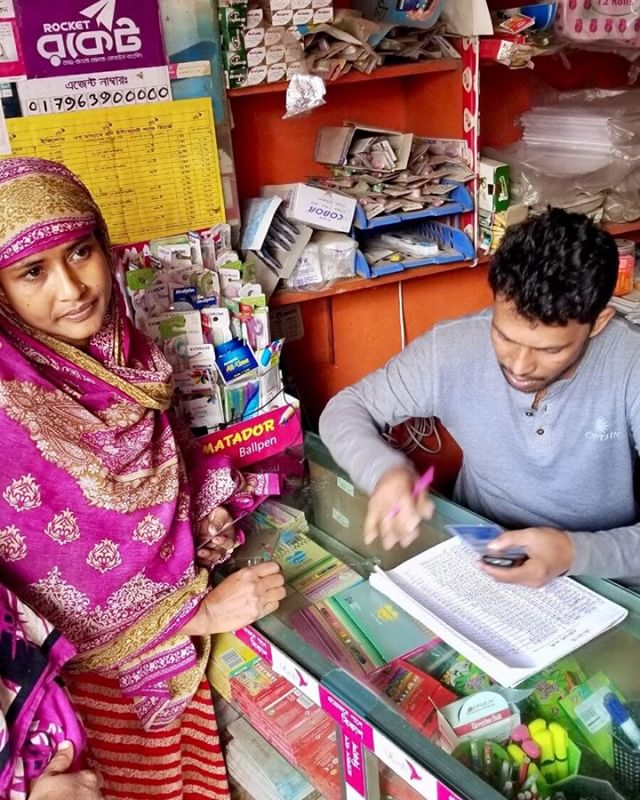 SAJIDA's client paying her loan installment at a trusted merchant and rocket agent in her neighborhood. She is able to pay her loan installments showing just her ID card in a matter of minutes.  #optixproject #mobilemoney #bangladesh #fintech #financialinclusion #dhaka #sajidafoundation