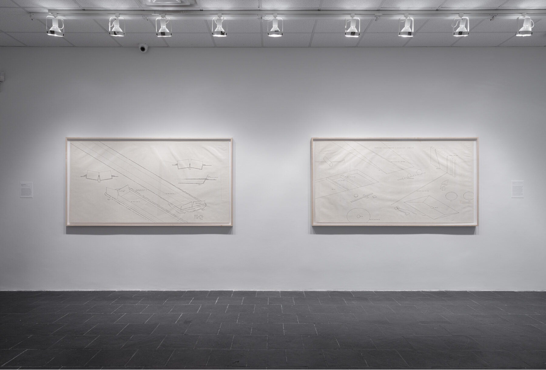 Installation view:  Robert Morris: Para-architectural projects , Hunter College Art Galleries, 2019.LEFT: Observatory Markers, Equinox Sunrise–Sunset , 1971. Ink on paper, 42 x 82 ½ in. (107 x 210 cm). Estate of Robert Morris, courtesy Castelli Gallery, New York.RIGHT:  Morning Observatory   Exercise Complex , 1971. Ink on paper, 42 x 82 ½ in. (107 x 210 cm). Estate of Robert Morris, courtesy Castelli Gallery, New York. © 2019 The Estate of Robert Morris / Artists Rights Society (ARS). Photo: Stan Narten