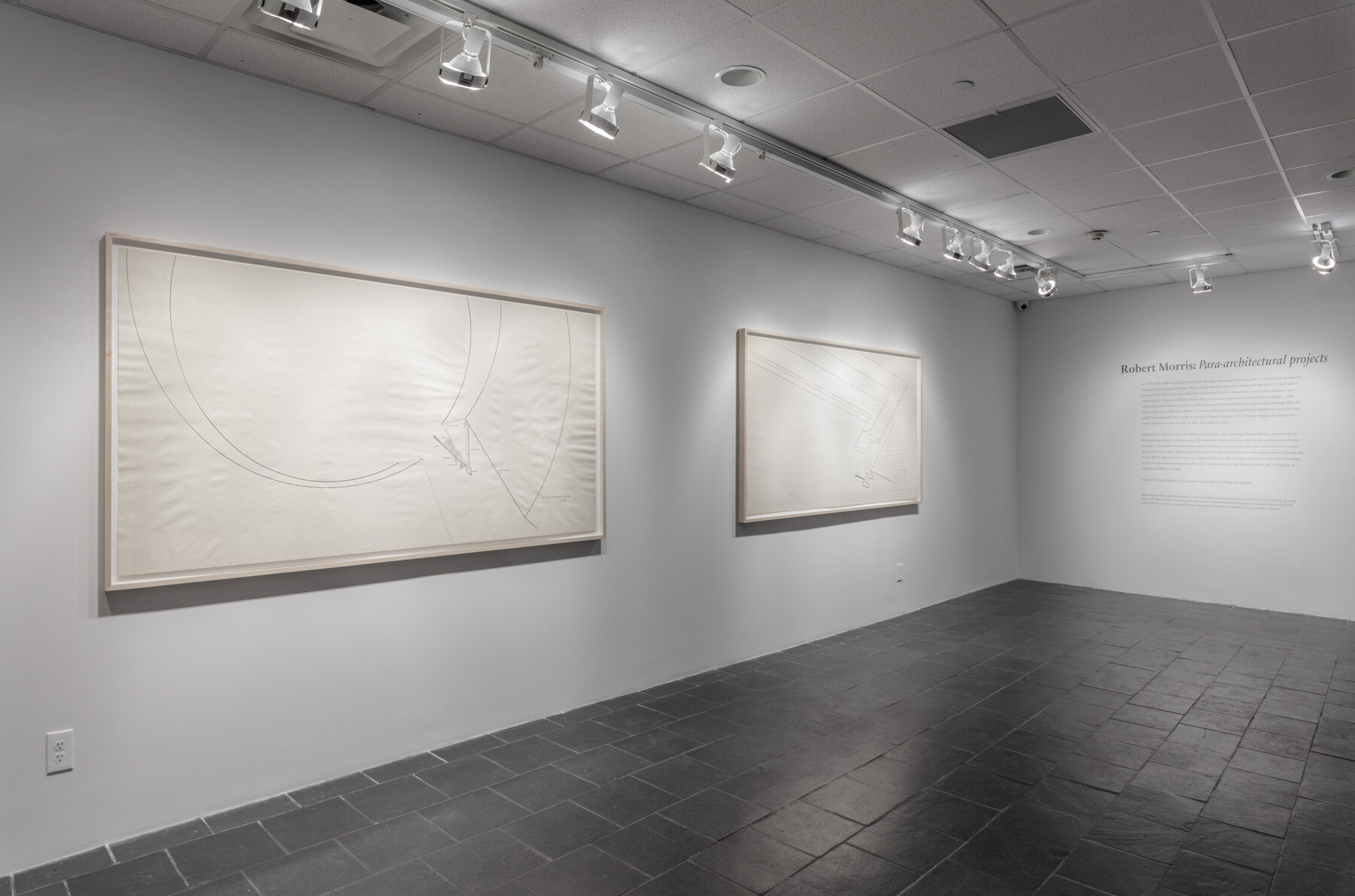 Installation view:  Robert Morris: Para-architectural projects , Hunter College Art Galleries, 2019. LEFT:  Section of an Enclosed Courtyard , 1971. Ink on paper, 42 x 82 ½ in. (107 x 210 cm). Estate of Robert Morris, courtesy Castelli Gallery, New York. RIGHT:  Section of a Walled Courtyard , 1971. Ink on paper, 42 x 84 in. (107 x 213 cm).Courtesy of Hunter College, The City University of New York. © 2019 The Estate of Robert Morris / Artists Rights Society (ARS). Photo: Stan Narten