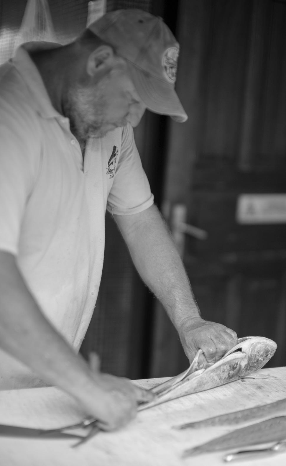 Fisherman at Fish Market / Pêcheur à la Poissonnerie  - Gustavia