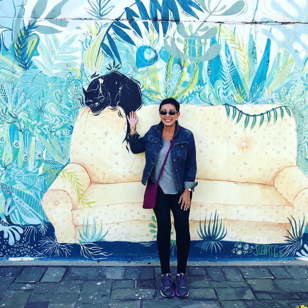 Alicia in Quito, Ecuador enjoying street art in La Floresta