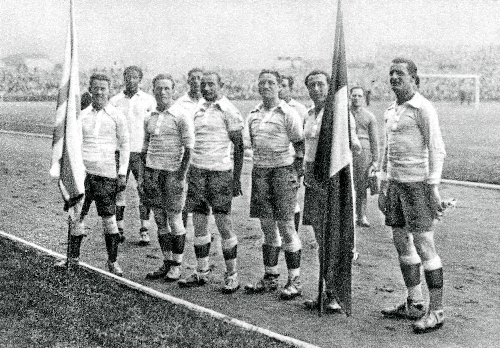 The Uruguay players at the 1924 Games. Andrade stands back from his teammates, second from left // PA Images