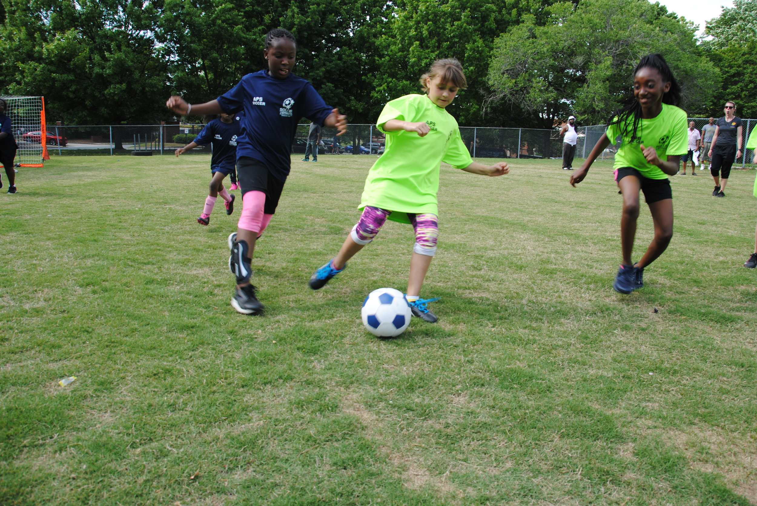 More than 100 girls play soccer at Dunbar Elementary during Soccer in the Streets' final girls game day for the Spring Season, .