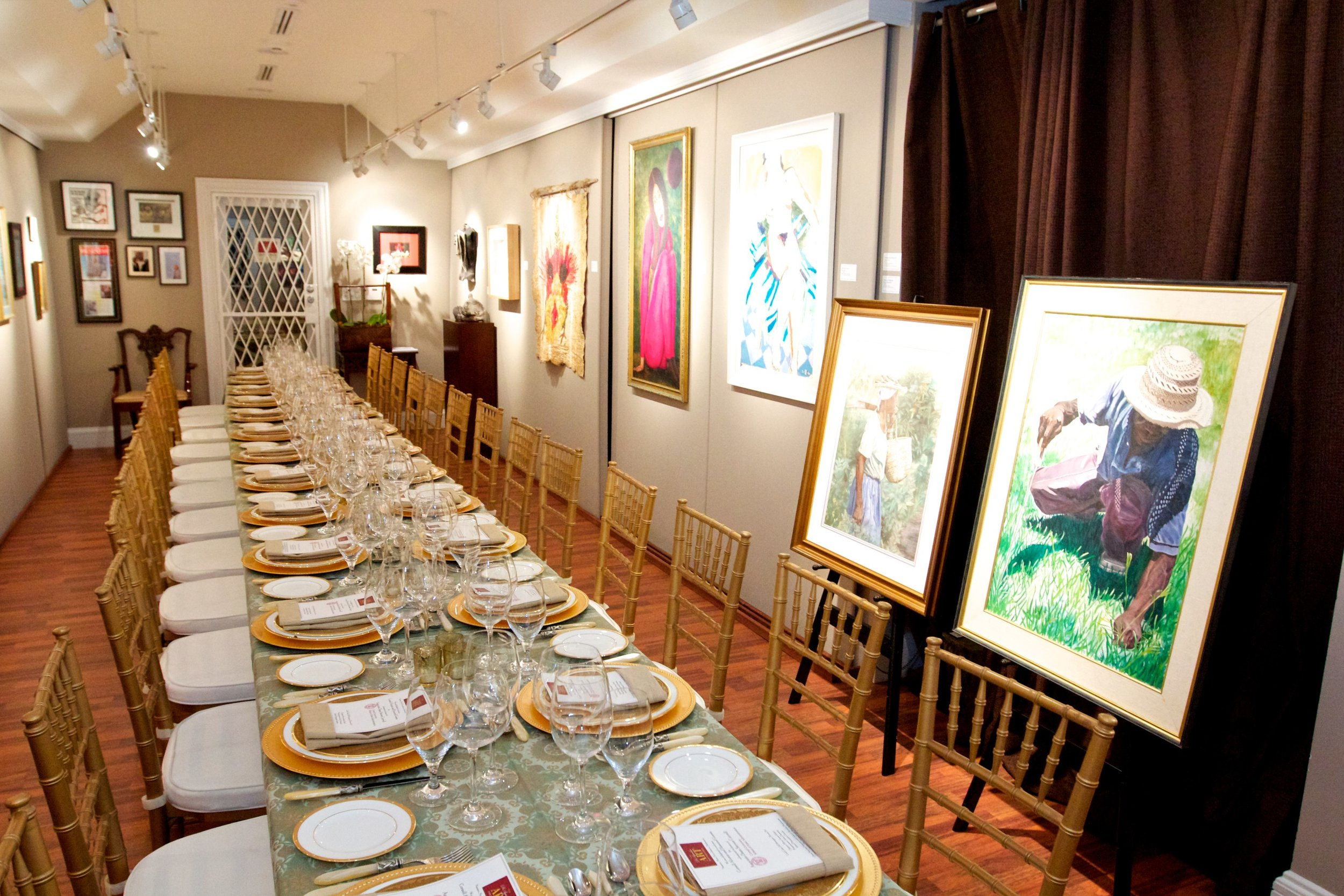 The main gallery space of the D'aguilar Foundation featuring a collection of works by prominent Bahamian artists.