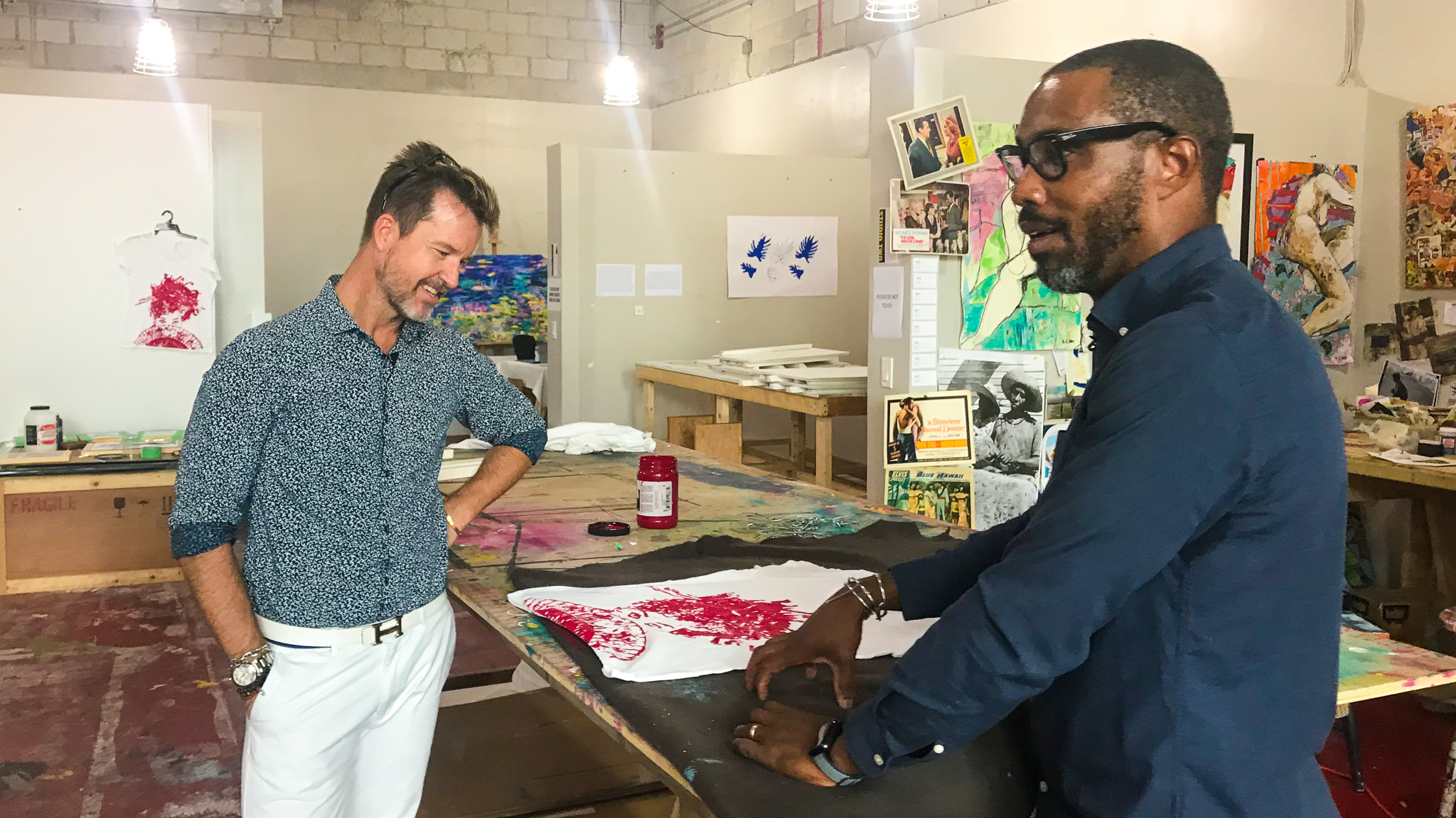 Shawn M.Sawyer and John Cox standing in admiration of a screen printing completed in The studio.
