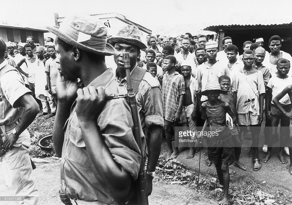 Federal Soldiers With Biafrans In The Background.