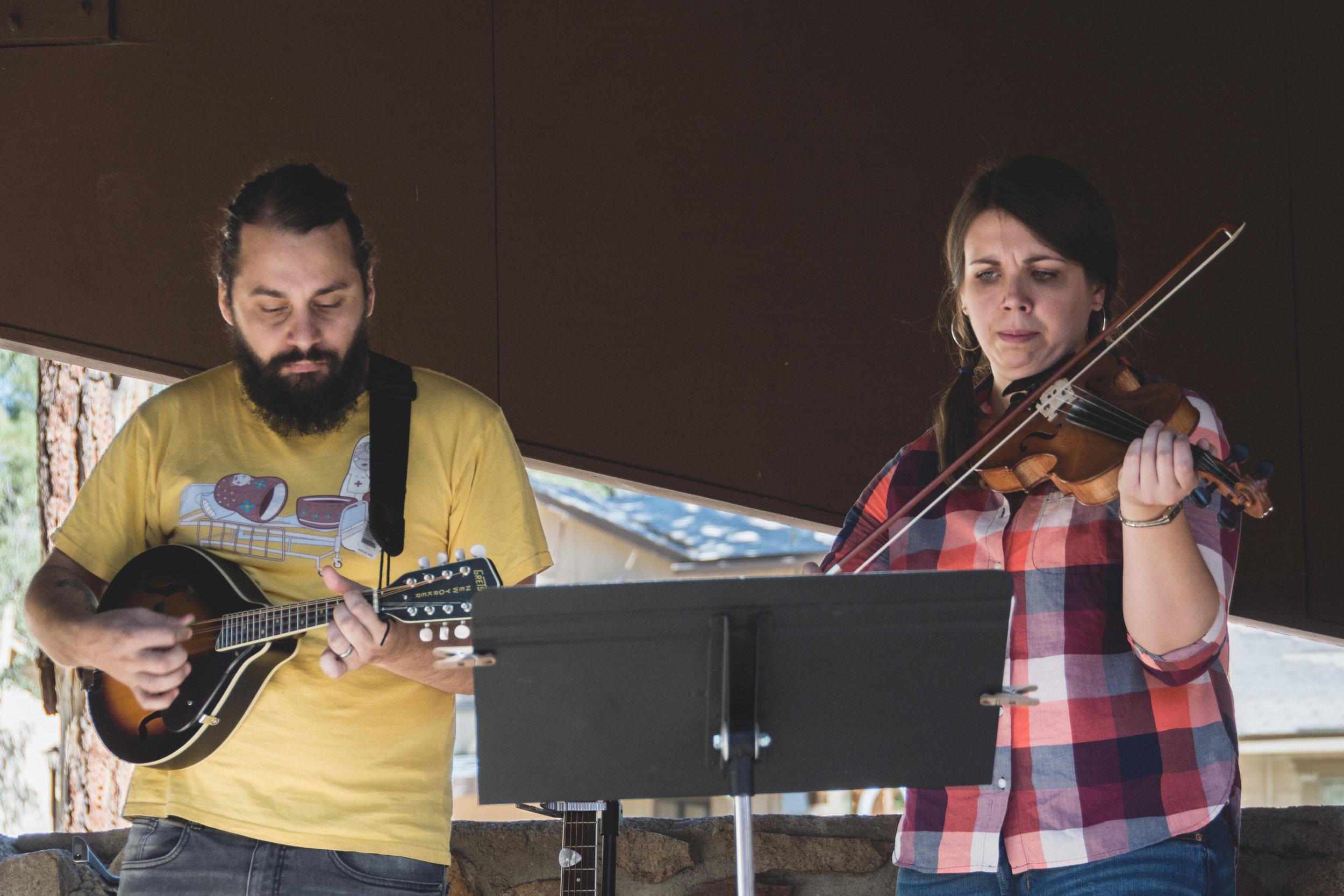 Josh pretends he knows how to mandolin alongside TMC's new teaching pastor, Meghan Good, at the fall church retreat.