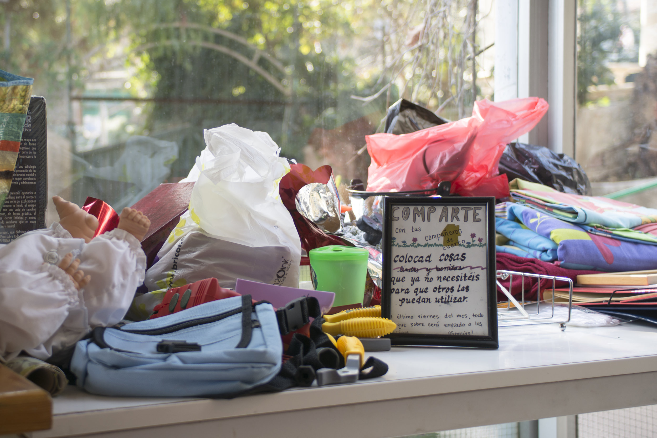 """An example of sharing resources in our Community House: A """"give-and-take"""" table."""