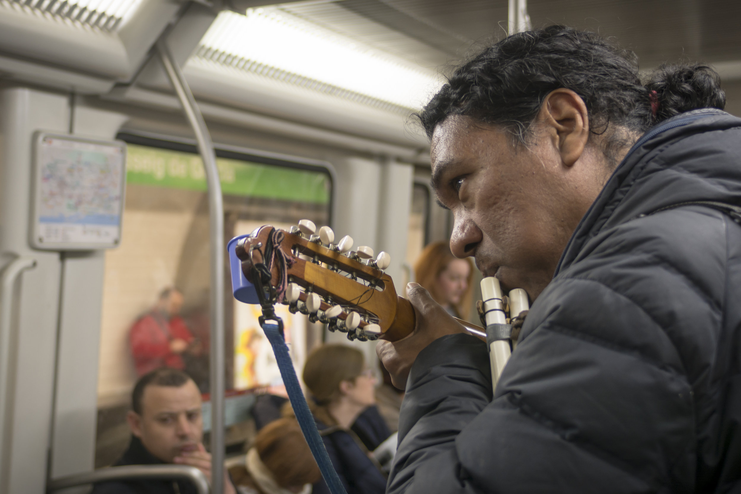 """I see this guy busking on the Barcelona metro quite often and it's always a highlight. He reminds me that """"enough"""" can simply look like contentedness doing something you love — like playing music."""