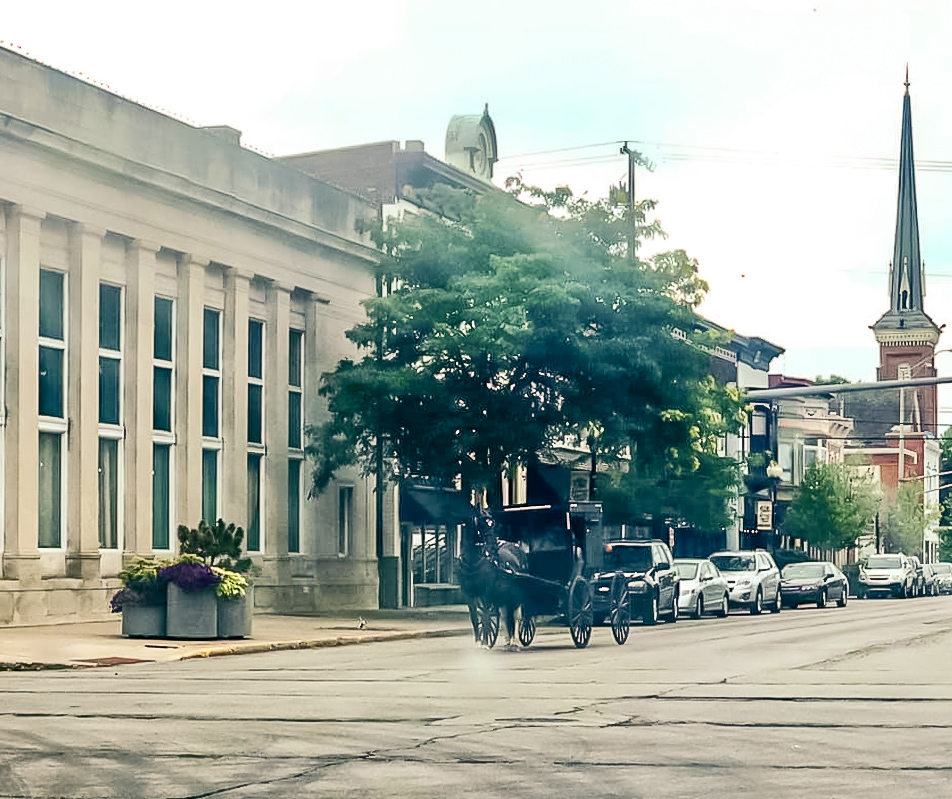 An Amish horse and buggy waits at a stop light in downtown Goshen. Alisha grabbed this photo during a missions seminar this past summer.
