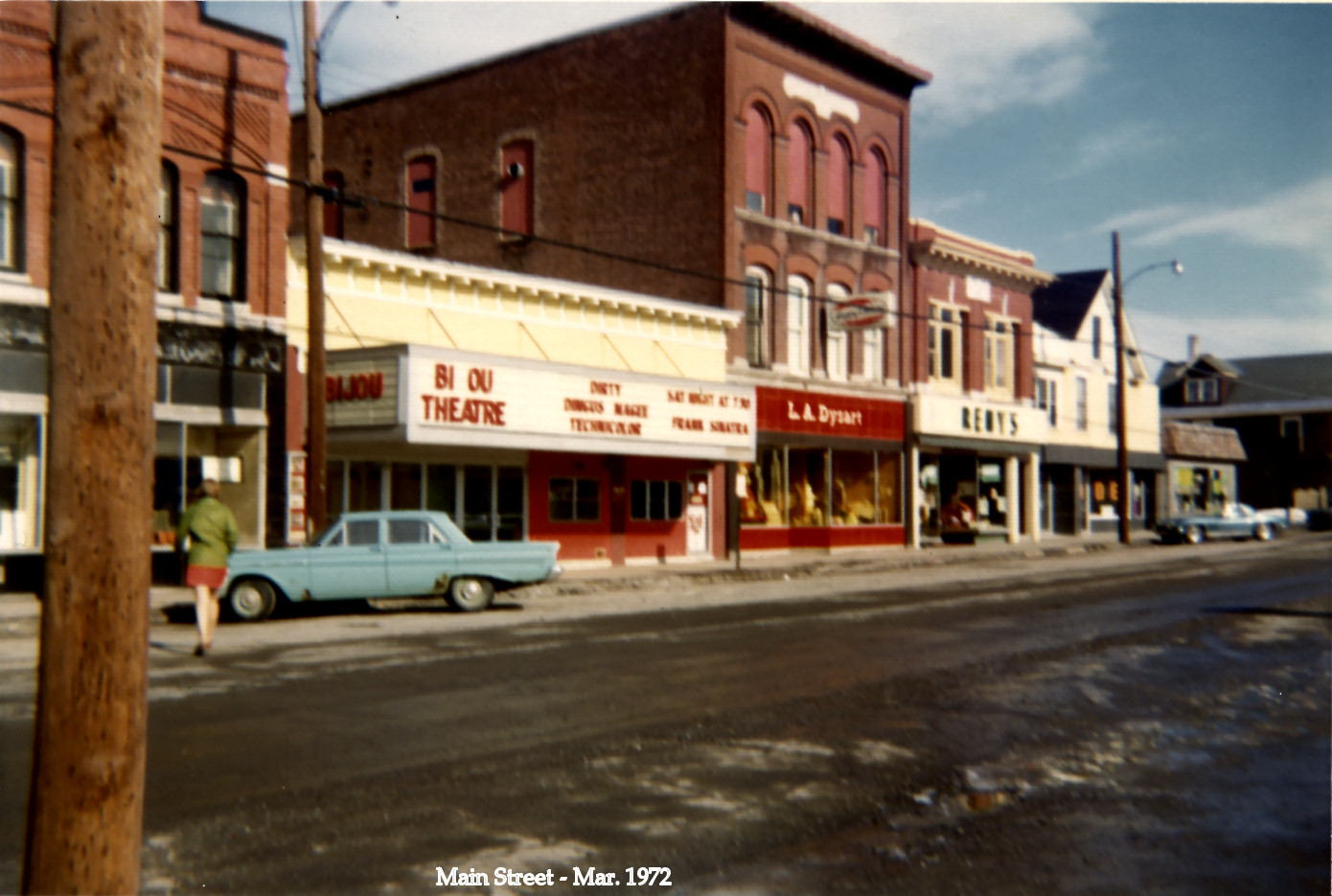 """The Bijou in 1972, a few years before it was sold to the town. Next door you'll see my grampy Dysart's department store. The theater is showing """"Dirty Dingus Magee"""" (in technicolor!) two years after it was released. Frank Sinatra as the title character."""