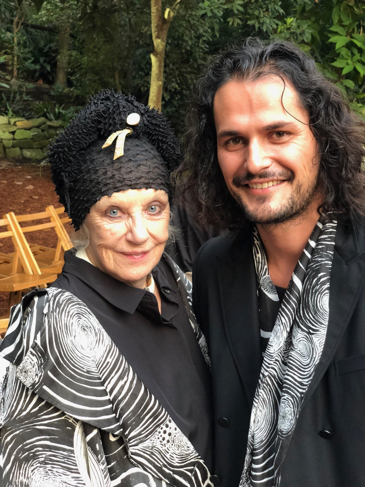 Wendy Whiteley wearing a custom-made 'Starry Night' cloak, with Felix Forrest (husband of Aje designer Edwina Forrest) in a matching scarf