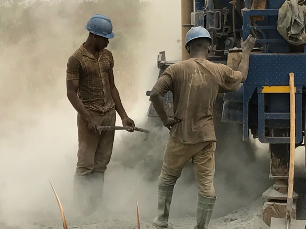 Local workers installing the new well system