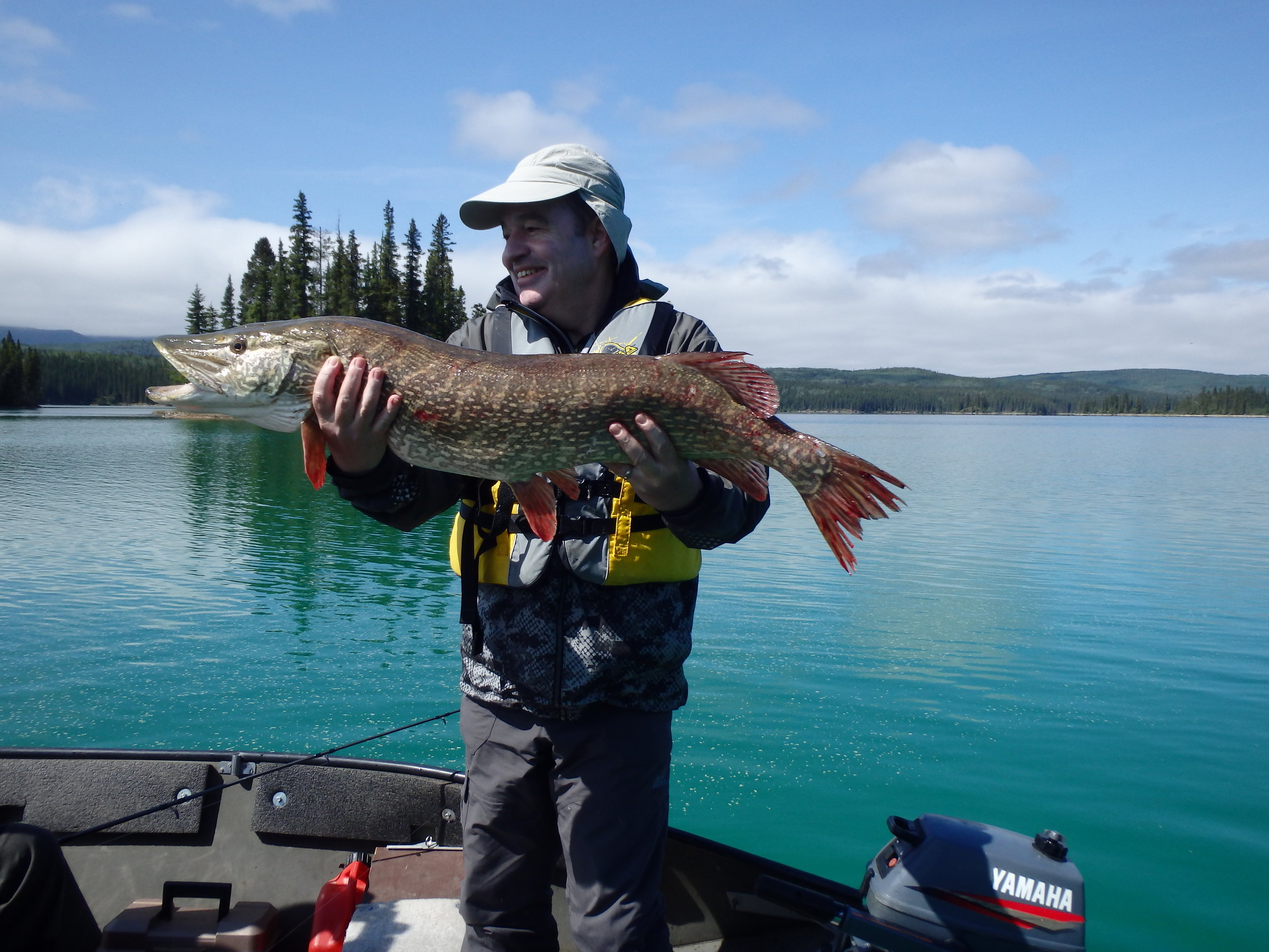 Happy fisherman with a huge Northern Pike!