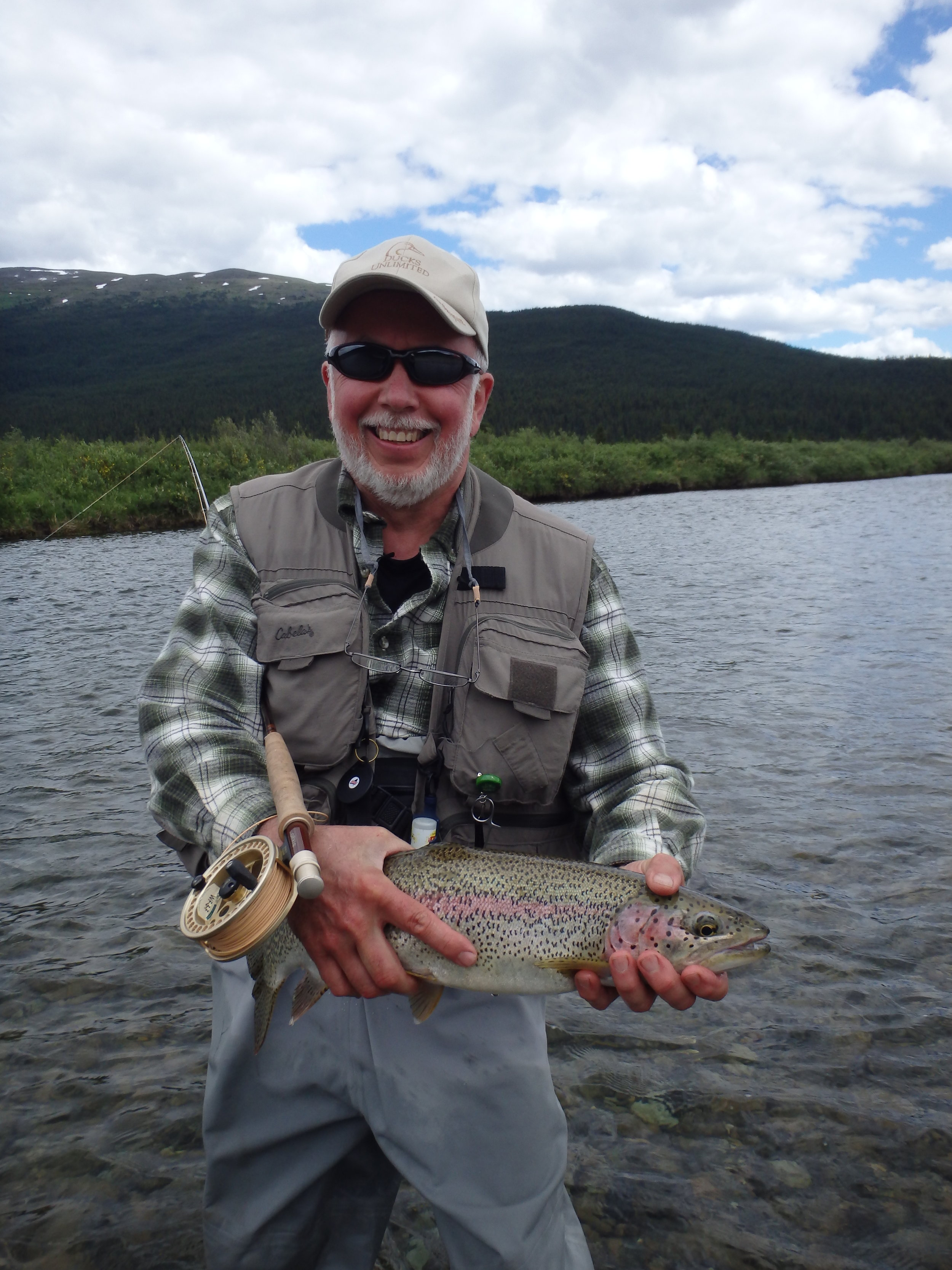 Proud fisherman with a Rainbow Trout