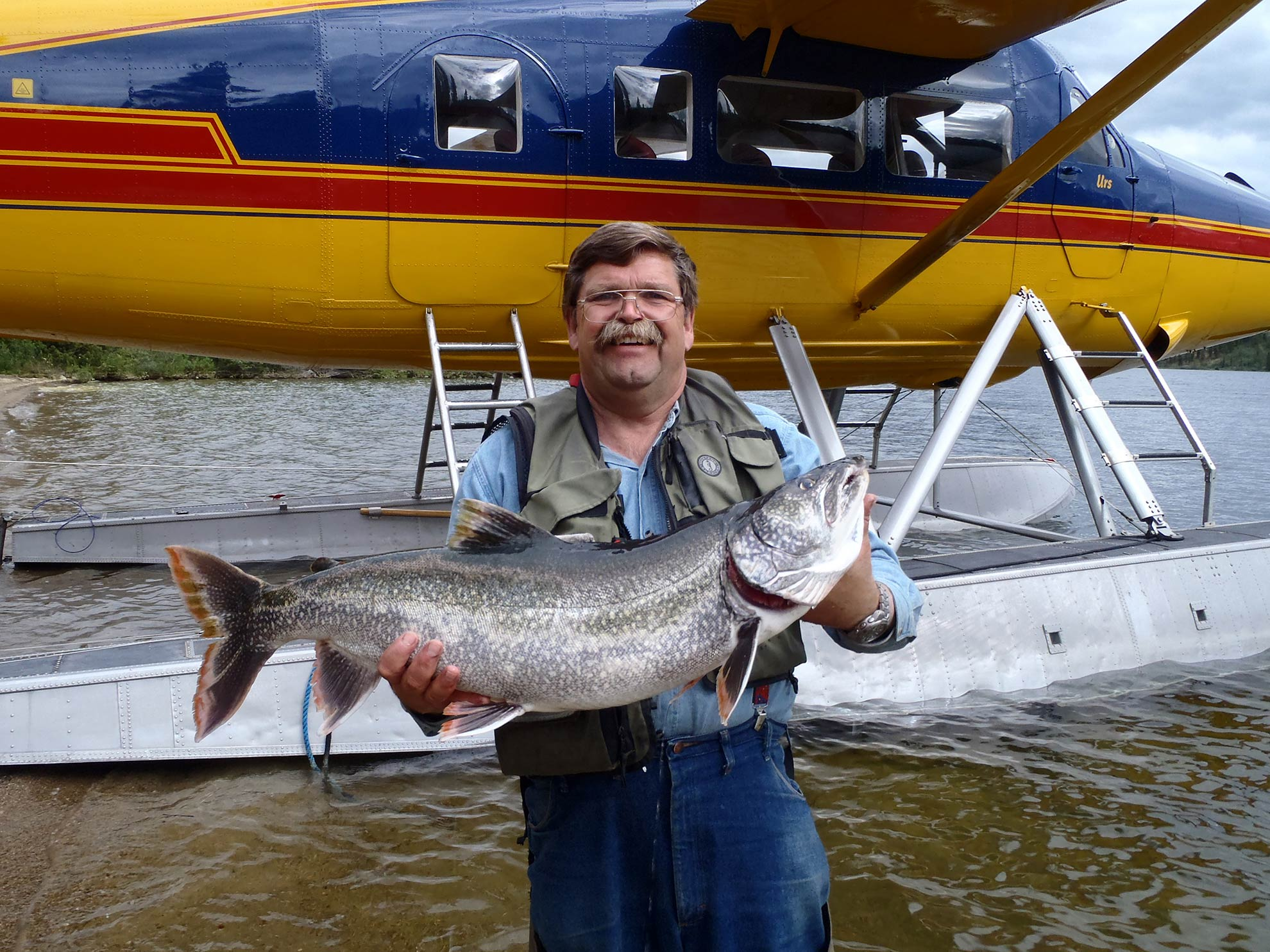 Bushpilot Urs, delighting with a days fishing