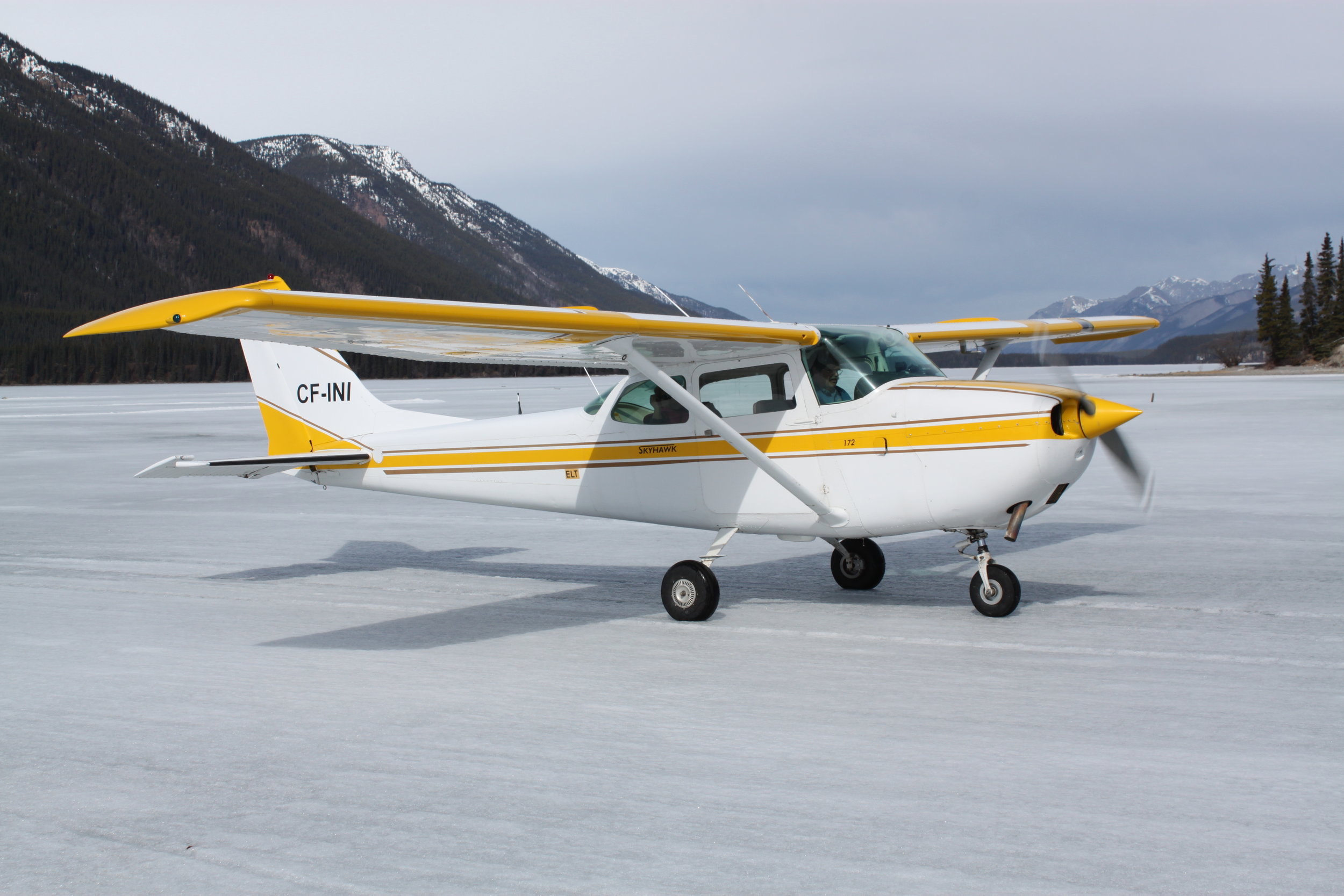 Cessna 172 returning from a winter sightseeing flight. Operating on our frozen Muncho lake icestrip in front of the Northern Rockies Lodge