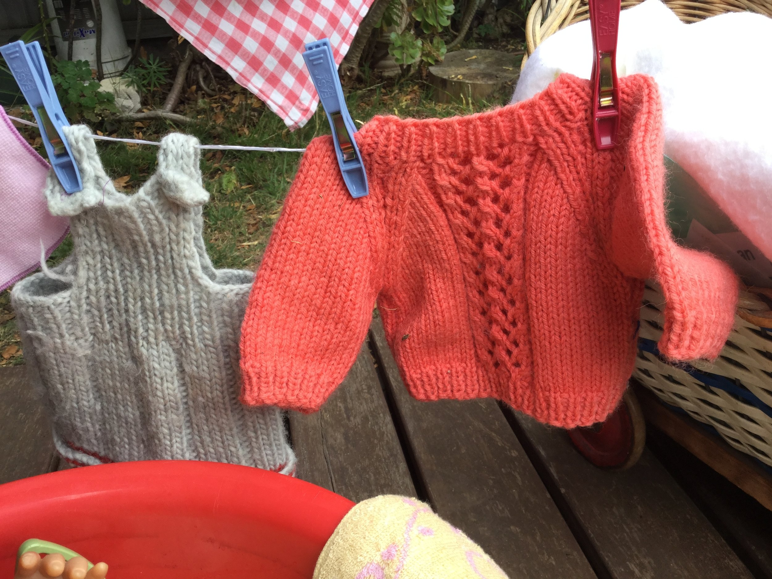 Facewashers and hankies are good to 'wash' and peg up if you don't have dolls clothes.